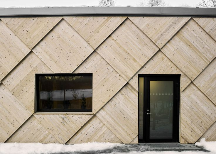 Big pine shingles cover the curving walls of this woodland trail centre by Swedish firm Tengbom, designed to mimic the form and texture of a pine cone