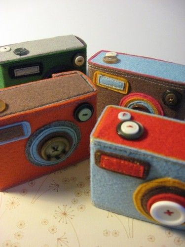 Felt and button DIY camera. Doing this!!! Can do it in the colors to match my living room. Orange and teals and greys and light tan!