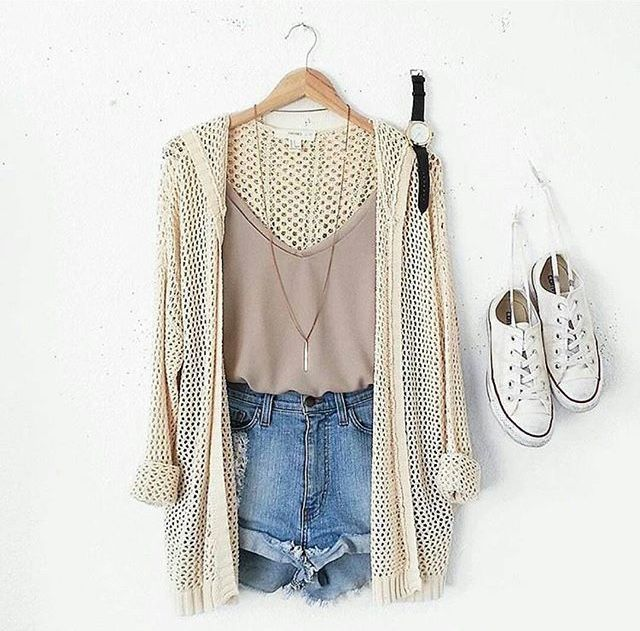Cute summer outfit with pink crop top, creme knit cardigan, jean shorts, and white sneakers