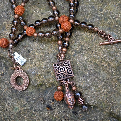 "Our Brahma Necklace has been designed with Rudraksha activated mala beads and Smoky Quartz Gemstones. A divine companion created to bring emotional grounding, promote self-empowerment and healthy, fearless living.  The Hindu god Brahma is the creator and director of the universe, the balance between the opposing forces of Vishnu and Shiva. Brahma means ""prayer"" in Sanskrit.  Length of the Necklace is 26""(66 cm) Charms  approx. 1"" (2.5 cm)  Fi…"