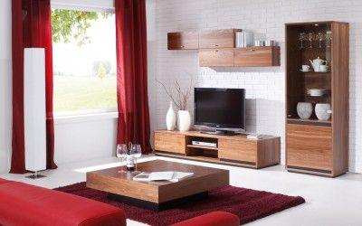 Nowoczesny salon z meblami Mobiliani. Na środku salonu znajduje się podnoszony ławostół wykonany z klasycznego drewna.