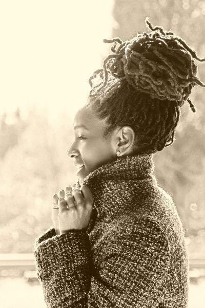 Sepia toned photo of woman with long locs + tweed coat. This pic is so pretty! #dreadlocks