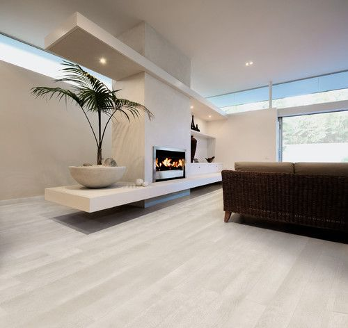 Porcelain wood effect tile helps create the look and feel of hardwood with out the maintenance. White Oak Porclelain