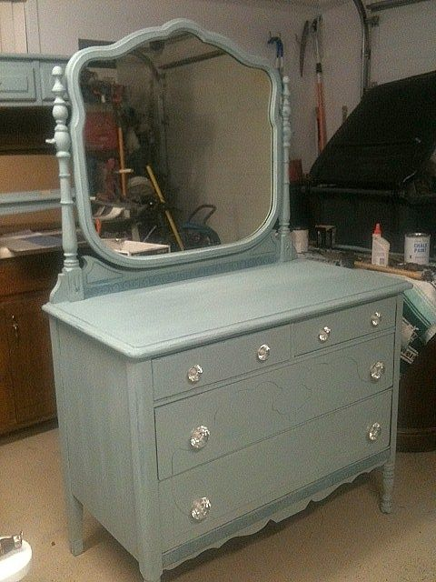 Duck Egg Blue Chalk Paint (tm) over Aubusson Blue with clear wax and new glass knobs. Budget ReDesign LLC.