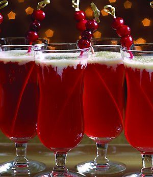 Mistletoe and Holly Cocktail *** Serves 4 1 1/2 cups cranberry juice