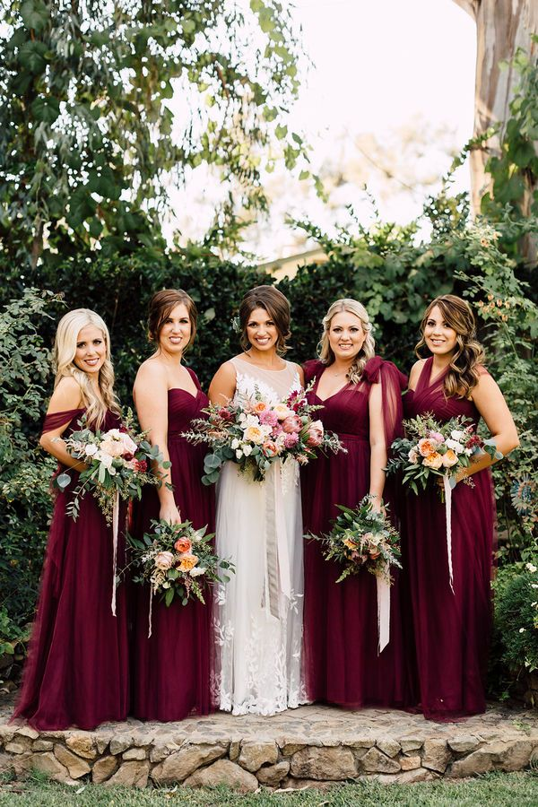 Mismatched Red Bridesmaid Dresses: If you are worried that a bright red hue for the bridesmaid dresses might take away from your immaculate white, choose a darker shade. Burgundy and maroon have been very popular in the last few seasons, so finding a dress style that suits all your ladies should be easy-peasy. | Gorgeous Ideas for a Red Wedding Palette
