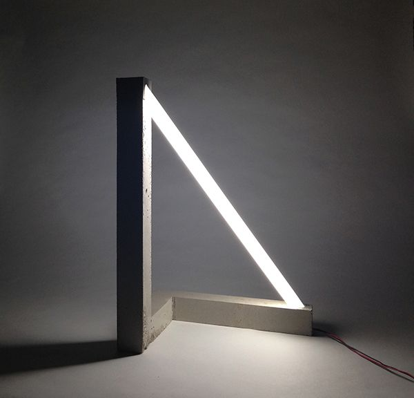 The Hypotenuse Light is a concrete and fluorescent tube lamp.