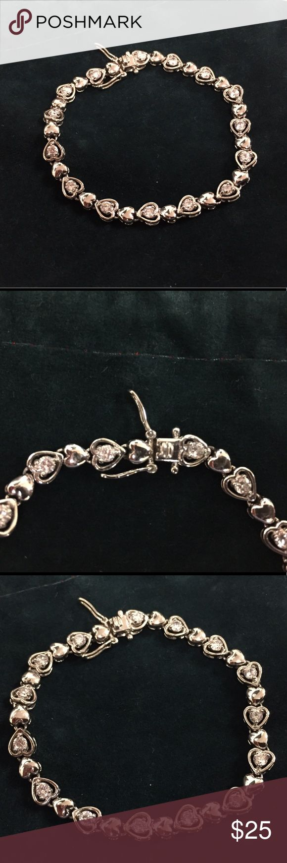 "Heart Shaped Tennis Bracelet 💙Gorgeous alternating silver and crystal (CZ) hearts. Sterling silver. Double safety latch closure. Approximately 7 1/2"" in length. In excellent condition. Jewelry Bracelets"