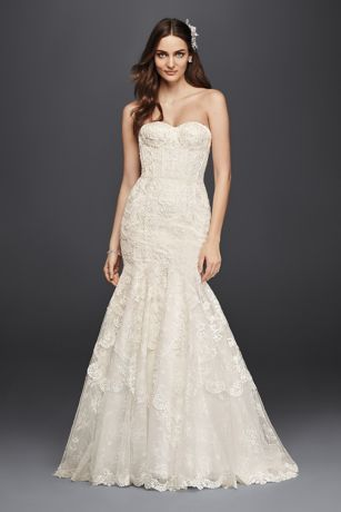 Five different styles of lace make up the intricate pattern that adorns this glamorous wedding dress. A corset-style sweetheart bodice and mermaid skirt give the look drama.  Galina Signature, exclusively at David's Bridal  Petite  Polyester  Chapel train  Back zipper; fully lined  Dry clean  Imported  Also available in regular,plus size ,extra length, and plus size extra length