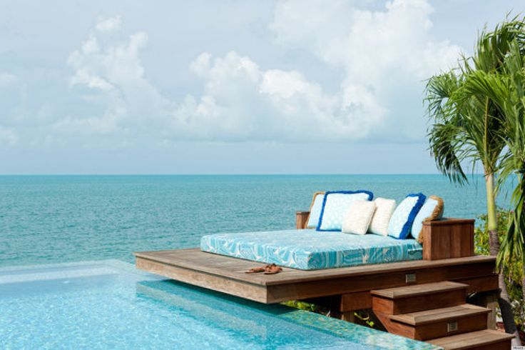 Bed with ocean view by the pool