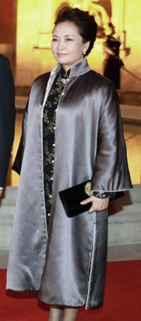 Ms. Peng had a silvery gray Mandarin coat cover her embroidered black Mandarin dress
