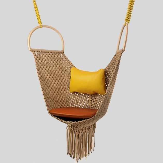 """Patricia Urquiola's swing chair for Louis Vuitton's """"objects nomades"""" collection"""