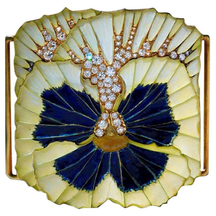 """Rene Lalique Plique-a-Jour Enamel and Diamond Plaque de Cou. Plique-a-jour enamel and diamond """"Plaque de Cou"""", in the form of a pansy flower, decorated with plique-a-jour enamel, the rich blue centre enhanced with silver paillons within the flux, the whole finished with a mixture of old brilliant cut and rose cut diamonds. By Rene Lalique, Paris c.1905"""