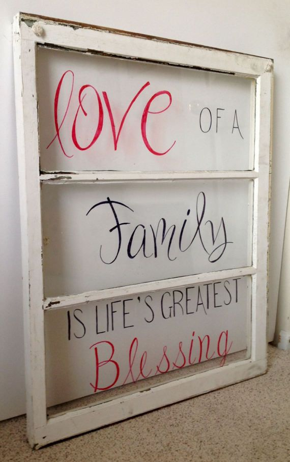 Repurposed 34 1/2 x 27 old window painted Love of a family is lifes greatest blessing. All hand painted. No stencils used. Black and red lettering. Clothesline rope for hanging.