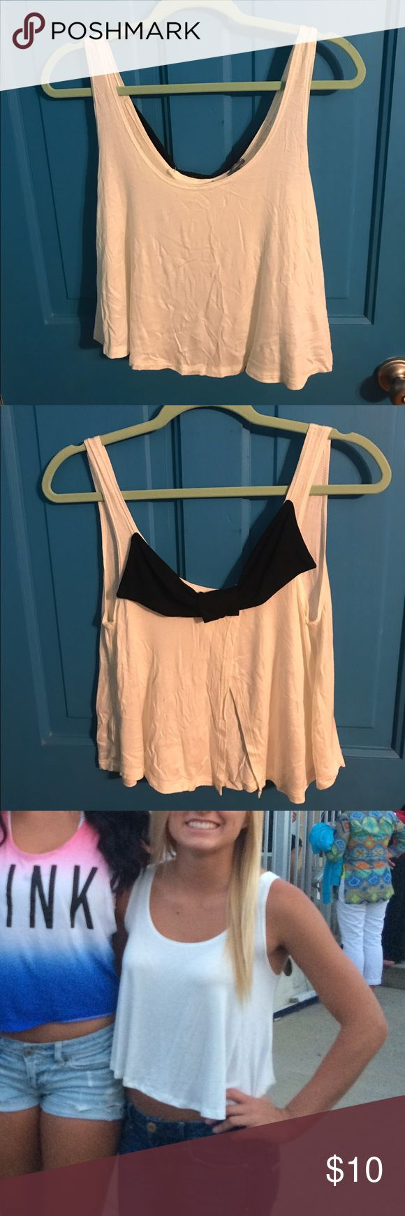 White Bow Back Tank White Bow Back Tank, only worn once no stains great condition Charlotte Russe Tops Tank Tops