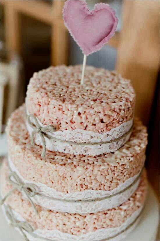 3-tier rice krispie cake using ribbons to decorate and add a fun cake topper