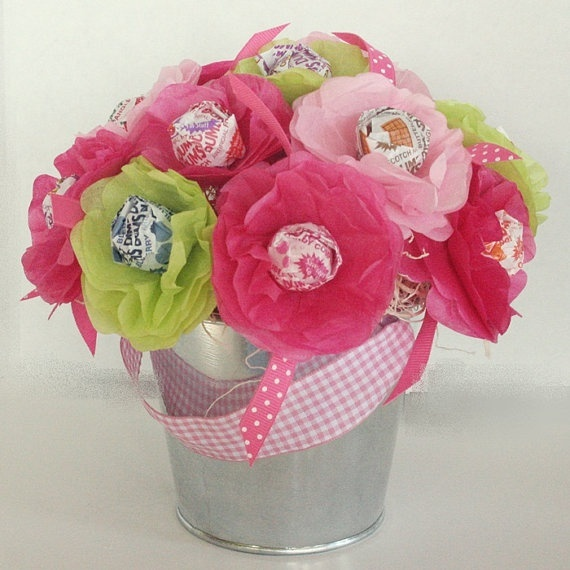 tissue paper flowers with a lollipop center. Very cute for girly parties...adults too (mothers day gift) jacksonamyjo