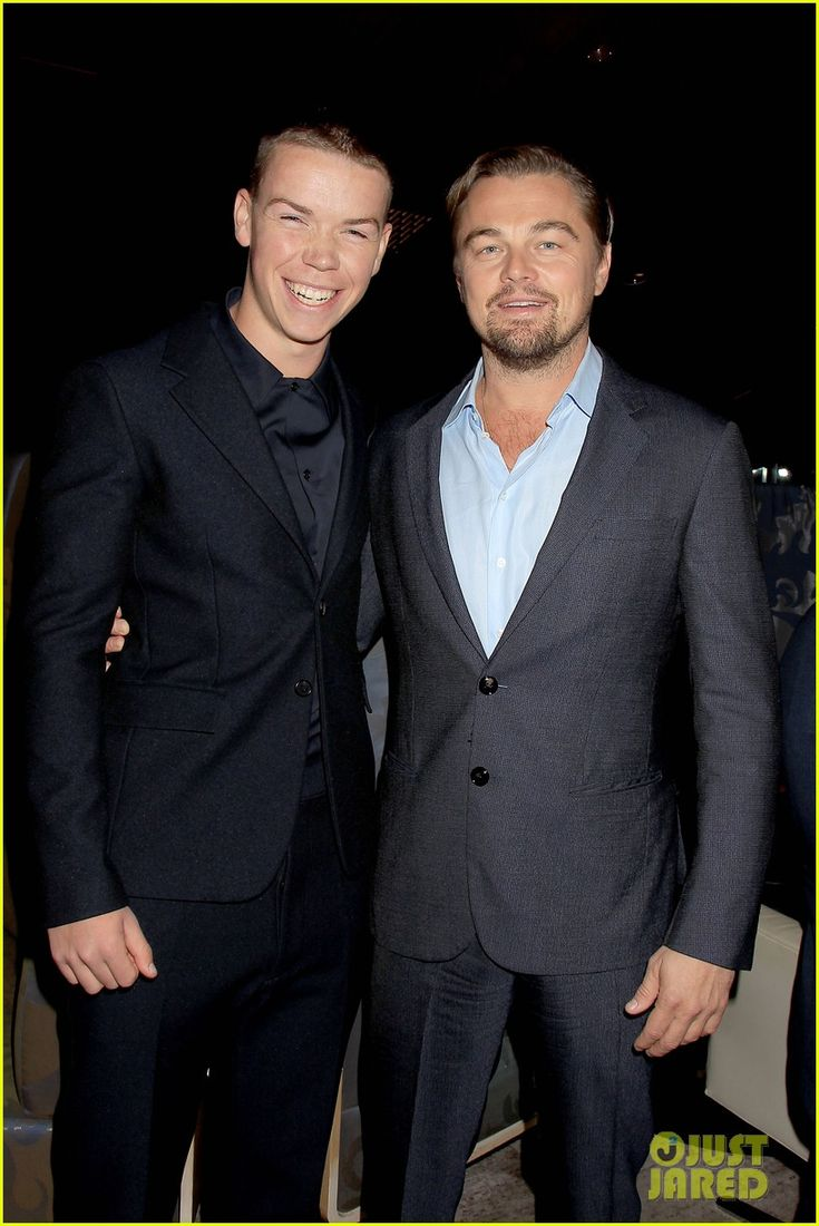 Leonardo DiCaprio flashes a smile while posing alongside co-star Will Poulter at a screening for their new movie The Revenant at AMC Lincoln Square in New York City on Tuesday (November 24, 2015)