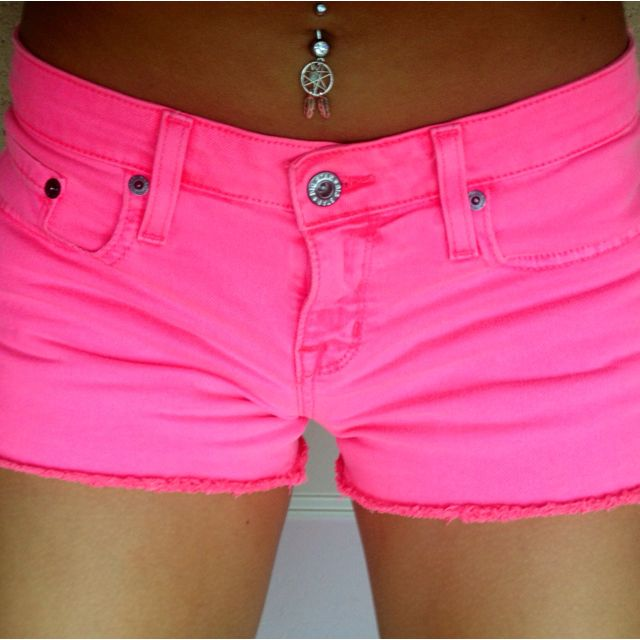 neon pink shorts and dreamcatcher belly ring <3