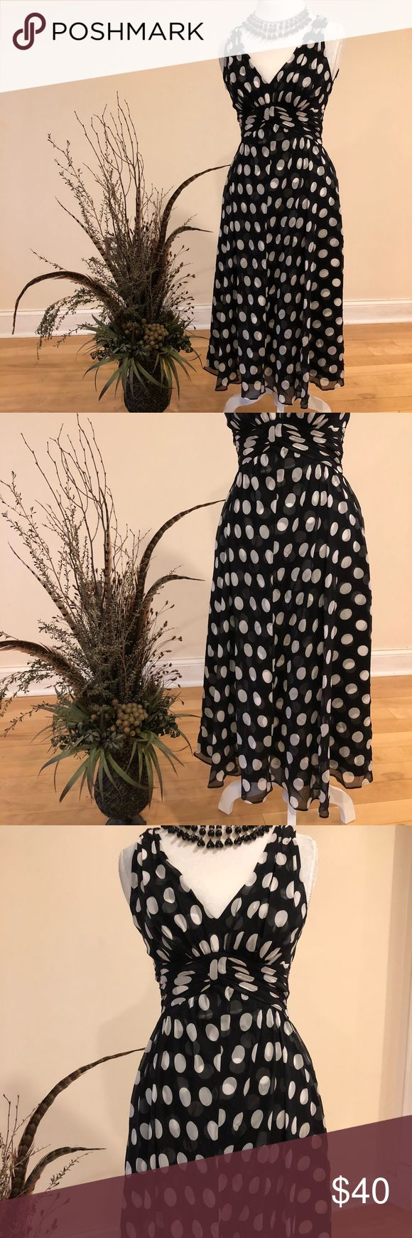 [White House Black Market] polka dot dress Shell 100% Silk, lining 100% Polyester.  Size 2, New without tags.  Halter top, polka dot print, gathered waste, zipper back.  Where it to the prom, wedding, party, night out on the town. White House Black Market Dresses