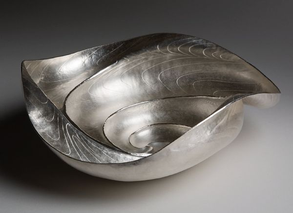 """""""Whirlpool bowl"""" by Miriam Hanid. Flat chased and formed on wood."""