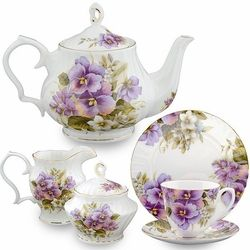 Create a flattering tea table with this lavish Pansy Bone China tea set.  The ornamental pansies pop with color against the white bone china background.   It includes 1 (6 cup) Teapot, Sugar & Creamer, 4 Cup & Saucer sets,4 dessert plates Bone China Gold Trimmed,    TRAY sold separate
