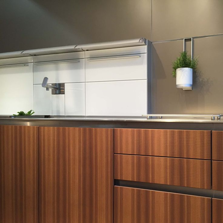 A warm combination of bulthaup smoked larch cabinet fronts for Bulthaup kitchen cabinets