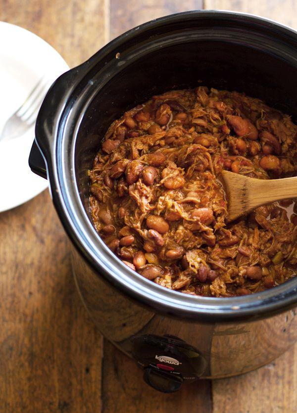 crockpot chalupas. pork shoulder and (dried)pinto beans in the crockpot. needs beer, fire roasted canned tomatoes, and jalapenos