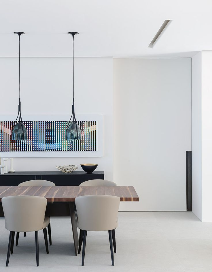 The Aston Chair by Minotti as featured at Bay House by Hare + Klein is one of the Authentic Dining Chairs that we are Loving Right Now - Hare & Klein Interior Design Blog
