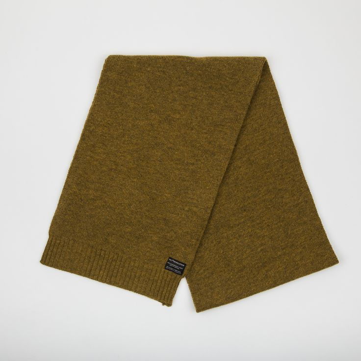 RVLT - men's fashion. Yellow heavy knit scarf made of soft melange look wool blend has the RVLT brand label.