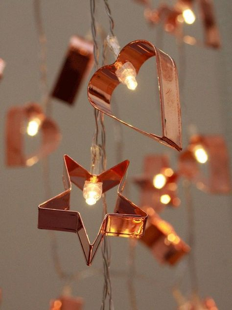 Cookie cutters sprayed with copper reflective spray paint, and used as  Christmas Light Reflectors~~Love these!