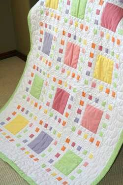 Large squares surrounded by white sashing and multiple small squares, in turn surrounded by white sashing. I wonder if this quilt is appliqued or sewn piece by piece