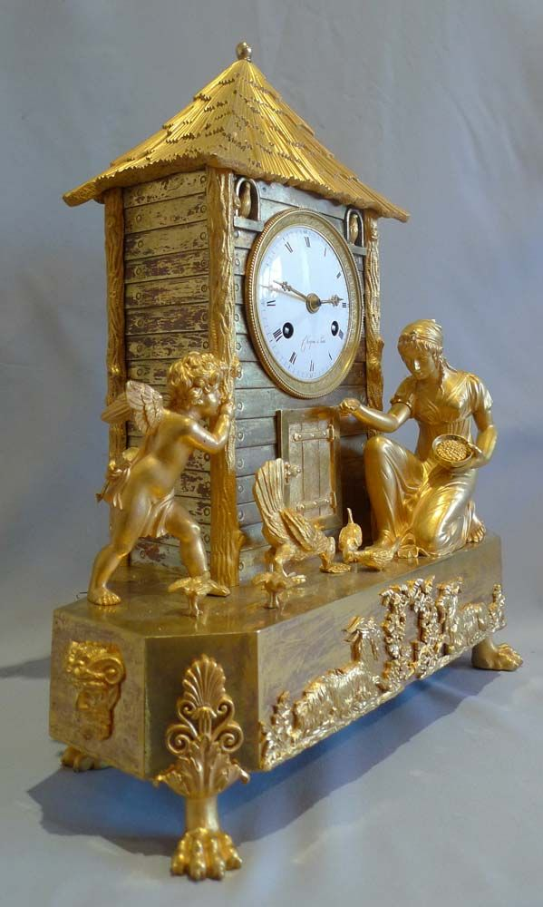 "Antique French Empire ""Genre"" mantle clock of woman and cupid with chickens...from Gavin Douglas Fine Antiques Ltd.  http://www.antique-clocks.co.uk/antique_clock_details.asp?stockNo=4544=3"
