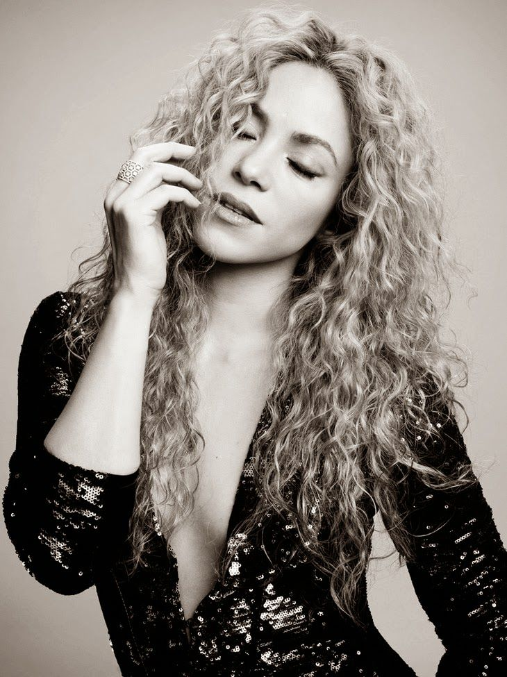 Shakira and her lovely wild curly hair that has a personality all it's own.  Would Shakira be as exotic without that beautiful mess atop her head?  I don't think so ;)
