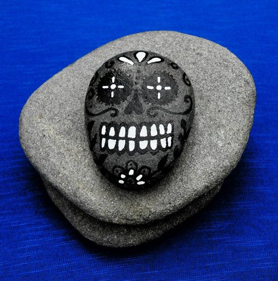Hand painted stone, black and white candy skull on a beach pebble, gothic day of the dead decorated rock, skull art on stone
