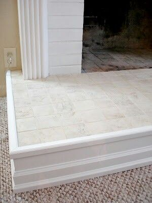 May need to trim the hearth to accomodate the herringbone tiles as we can't mitre the exposed edge. Consider using the same trim in living room of find one that is complimentary.