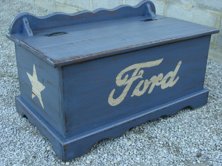 My childhood hope chest turned into my sons toy box. He loves Ford Mustangs, so I painted it up and distressed it all cool :)