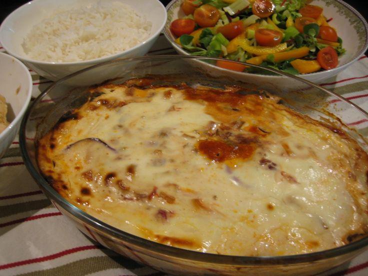 Baked Aubergines With Yoghurt  see details at https://garlic-recipes.com #garlicrecipes #smokedgarlic #barbismoked #aubergeines #veggies #lunch #vegetarianrecipes #mainmeals