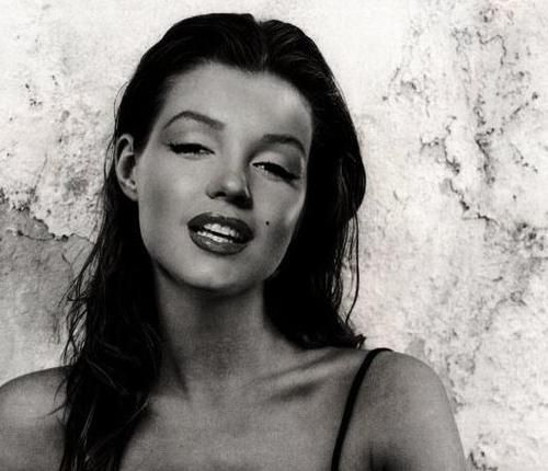 Marilyn as a natural brunette--I find her twice as striking this way.