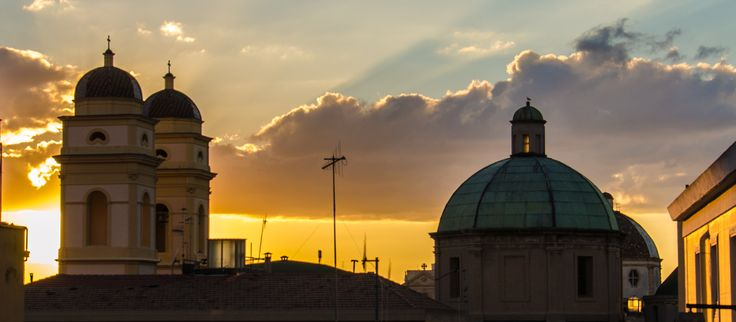 Who among you can tell to which church Cagliari belong these domes at sunset?