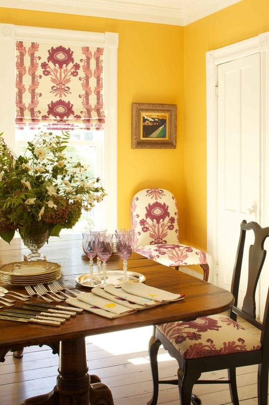 Egg yolk yellow walls contrasts with floral Quadrille fabric - Denemede design