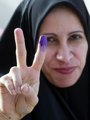 Iraqi Woman Holds Up Her Purple Finger, Indicating She Has Just Voted in Southern Iraq Photographic Print at AllPosters.com