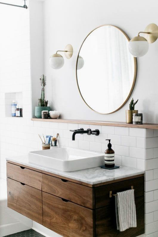 Top off your chic space with a sink and mirror tha…