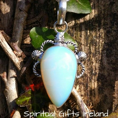 "Sun and Moon Opalite Pendant Visit our store at www.spiritualgiftsireland.com  Follow Spiritual Gifts Ireland on www.facebook.com/spiritualgiftsireland www.instagram.com/spiritualgiftsireland www.etsy.com/shop/spiritualgiftireland	 We are also featured on Tumbler  Opalite is known as the ""Eye Stone"" which explains the modern word optician.  Just as our eyes absorb light and reflect it back, so too does Opal. This gorgeous Sterling Silver Sun and Moon Pendant is all about reflection.  Despite…"