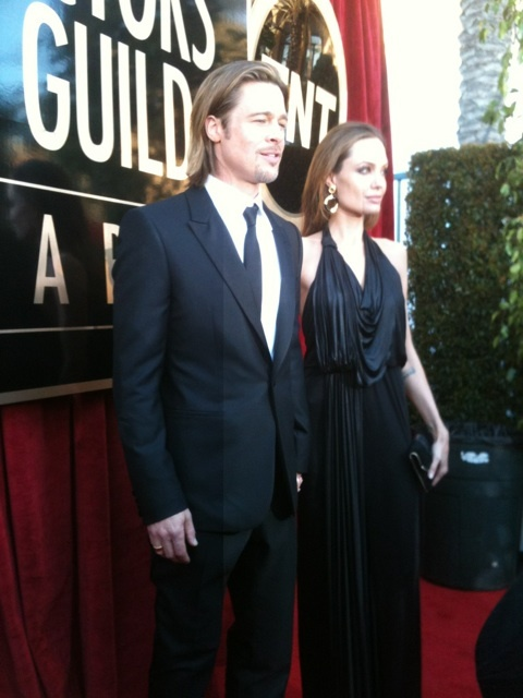 Brad Putt and Angelina Jolie. SAG 2012. She's so beautiful.. and skinny. Dislike his long hair.