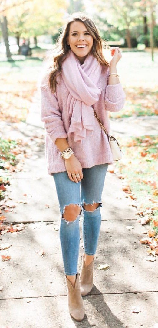 #winter #outfits women's pink scarf and pink shirt and blue-washed jeans. Click To Shop This Look.