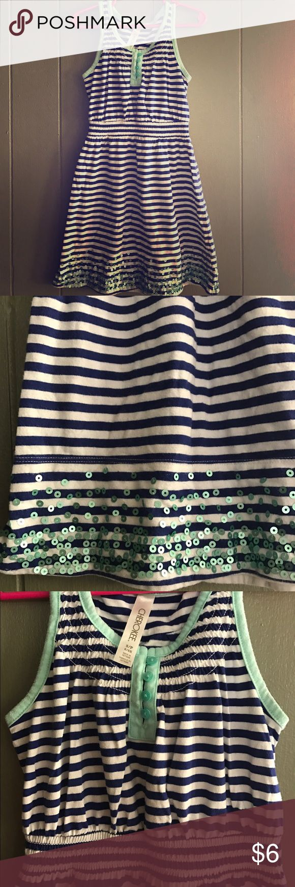 Girls pretty summer dress Very pretty girls summer dress. White and royal blue strips. Teal trim on arms and neck. Worn a handful of times. No rips, holes or stains. Cherokee Dresses Casual