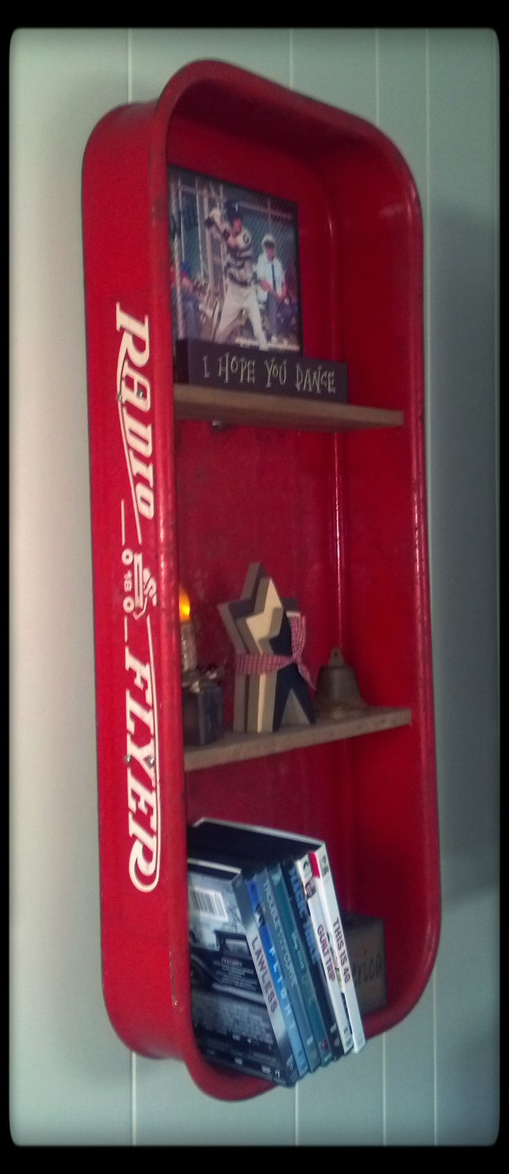Love the way this looks and the pop of color it provides. Radio Flyer wagon turned shelf