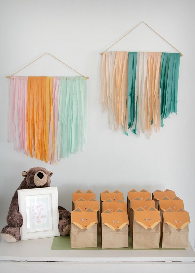 A Woodland Creature Birthday | Hanging paper banners add a pop of color and are super cheap to make! #diy #partydecor #papercrafts