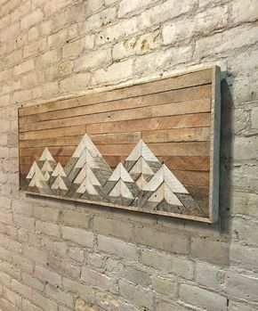 This one of a kind wall art is made from reclaimed lath wood. The finish is left…